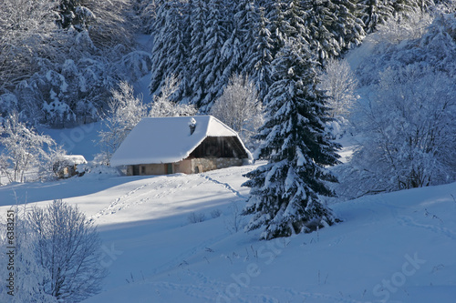 Landscape of mountain showing a house under snow