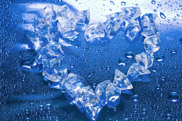 heart from ice on blue background