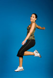 Woman in fitness outfit exercising poster