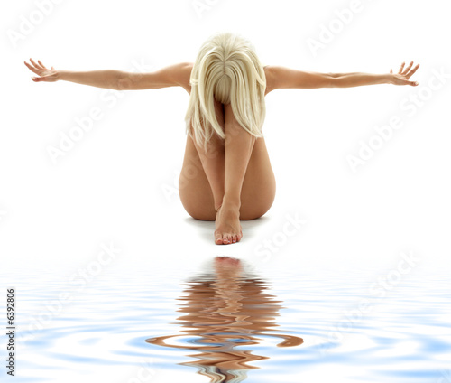 Leinwanddruck Bild artistic nudity style picture of woman on white sand