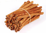 Big bundle of spicy cinnamon sticks isolated poster