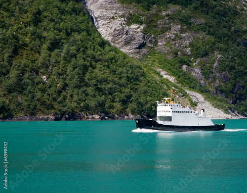 A Ferry crosses Geiranger Fjord in Norway