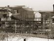 Old steel mill in winter, black and white, sepia toned