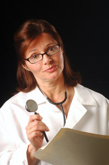 Doctor with concerned look holding chart and stethoscope