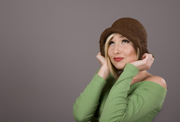 Blonde Holding Brown Hat Looking Up