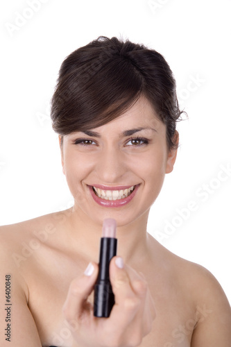 Woman doing makeup close up, focus on the face