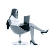 monochrome businesswoman with laptop in chair over white