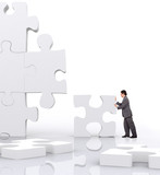 business man implementing a piece of a puzzle poster