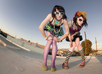 Fisheye shot of girls in brightly colored clothing on a roof