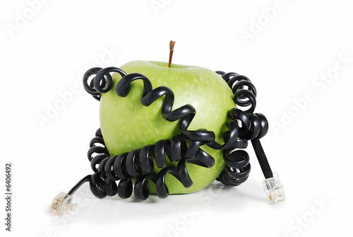 Green apple tied around with wire