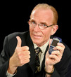 Middle aged businessman gives the thumbs up holding his PDA.