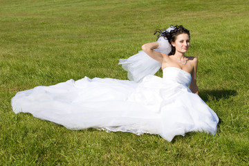 smiling bride on the grass