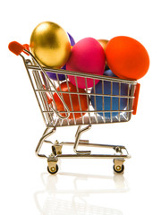 Many multi-coloured Easter eggs in the small store cart.