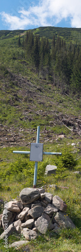 Cross under the partisan grave in mountains