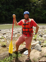 White-water rafter on the banks of Rio Pacuare, Costa Rica