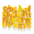 Plastic Alphabet in yellow tones on a neutral background
