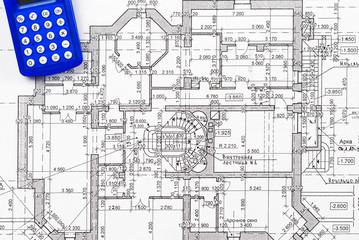 Calculator over house plan blueprints