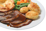 Roast beef with Yorkshire pudding, vegetables and gravy poster