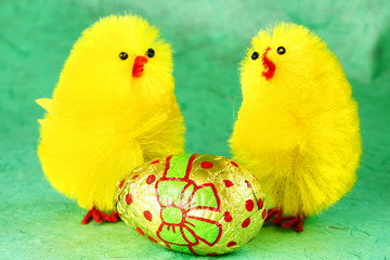 Easter chicks with an easter egg