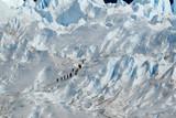 Trekking  on a glacier Perito Moreno, Argentina.. poster