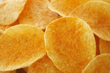 Crispy golden brown potato chips (shallow depth of field)