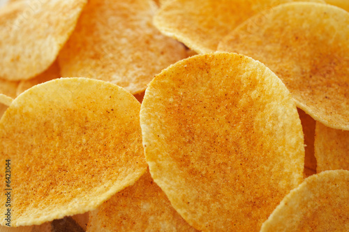 Crispy golden brown potato chips (shallow depth of field)