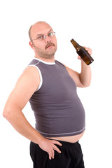 Overweight man holding a beer