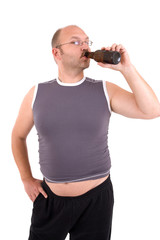 Overweight man with beerbelly having a sip from his beer