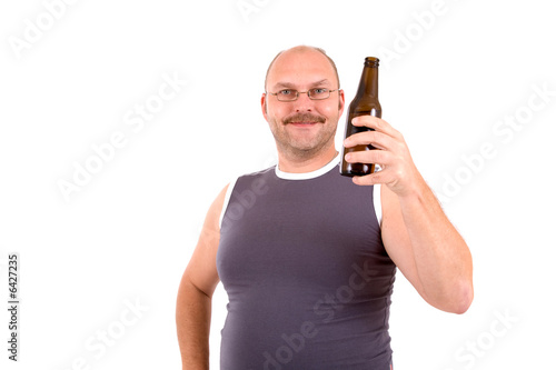 Overweight man holding a bottle of beer in his hand