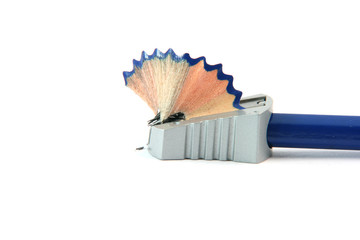 sharpening a pencil with  sharpener isolated on white