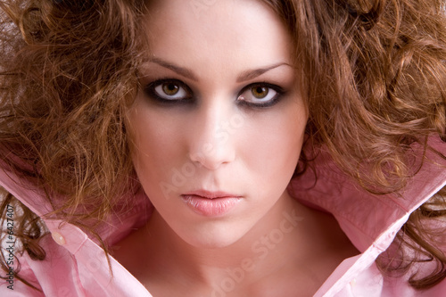 Beautiful brunette with dark smoky eyes and intense look