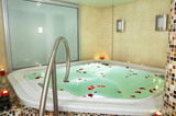 Bath of a jacuzzi with petals of roses. poster