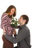 young man giving flower to darling girl poster