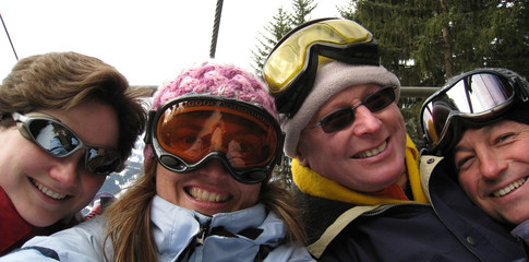 Friends on a chairlift in a ski resort
