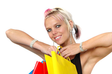 Beautiful blond with shopping bags isolated on white