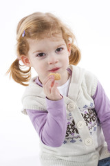 cute little girl eating cookie