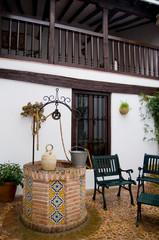 Well and botijo.In patio Castilla la Mancha. Toledo, Spain
