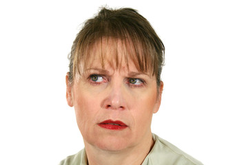 Middle aged female looking away with a frown.