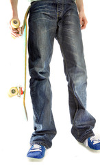 A teenager holding a skateboard