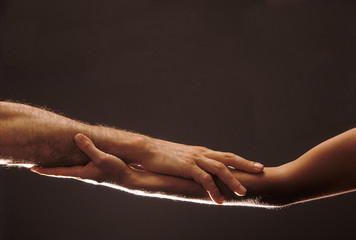 Woman and man's hands entwined, symbol of agreement, wedding 03