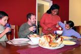 Family having thanksgiving dinner poster