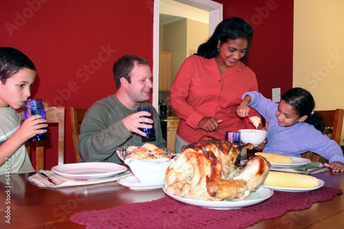 Family having thanksgiving dinner