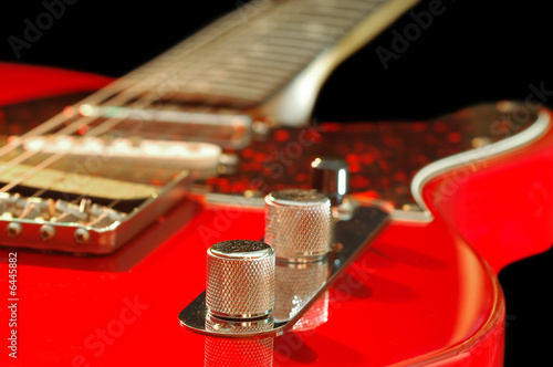 vintage red electric guitar close-up - 6445882