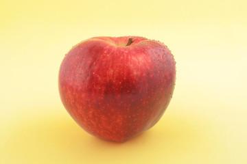Red Apple on gradual yellow background