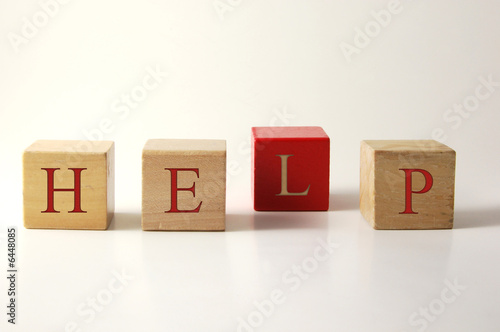 Four wooden toy blocks asking for help