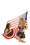 Attractive female American patriots with flag isolated  poster