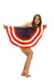 Attractive female American patriot with flag isolated over white poster