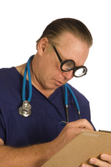 Male nurse or doctor with chart taking notes
