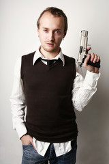 Portrait of a young man with a gun