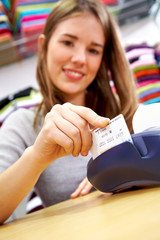 woman paying by credit card in a store